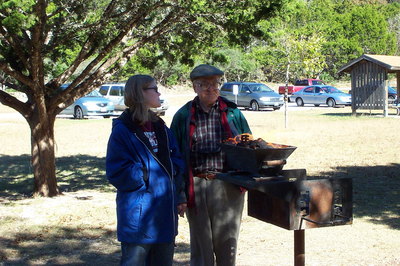 [Thanksgiving picnic at Lost Maples State Park]  Jenna and Grandpa get the grill fired up.