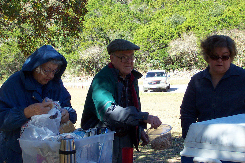 [Thanksgiving picnic at Lost Maples State Park]  Mom, Dad, and Wendy get things ready for lunch.