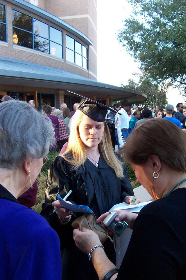 Come on, Mom, hurry up with the camera!!<br /> December 2006 graduation at Texas Lutheran University.