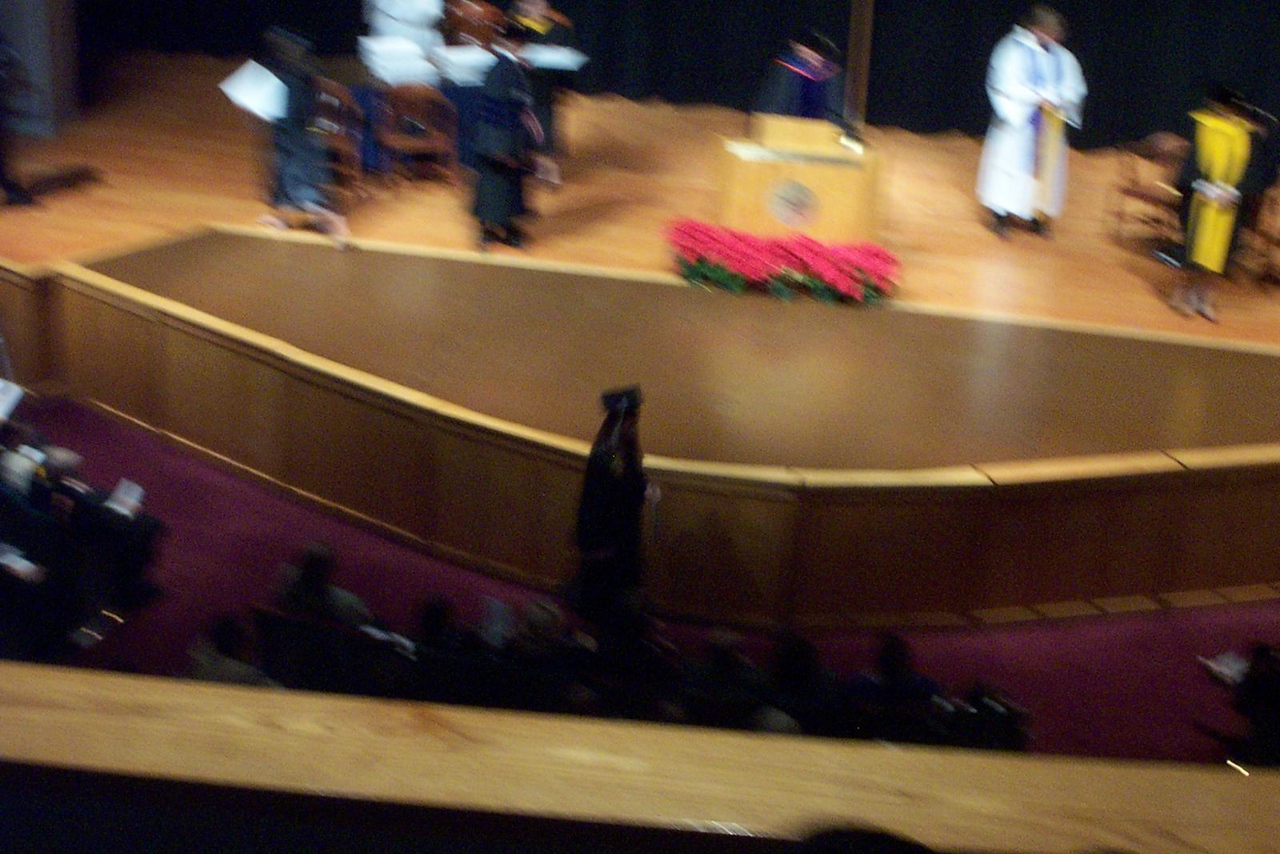 Sorry for the blurry photo! That's Jenna in front of the stage, headed back to her seat.<br /> December 2006 graduation at Texas Lutheran University.