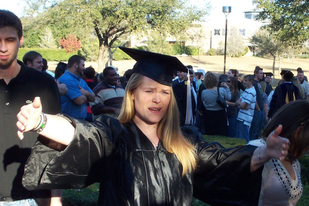 Okay, now gather around for pictures everyone!<br /> December 2006 graduation at Texas Lutheran University.