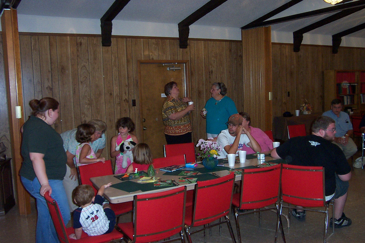 Kim (standing left), her kids Garrett & Myriah (both seated), and her husband Daniel (in white shirt)