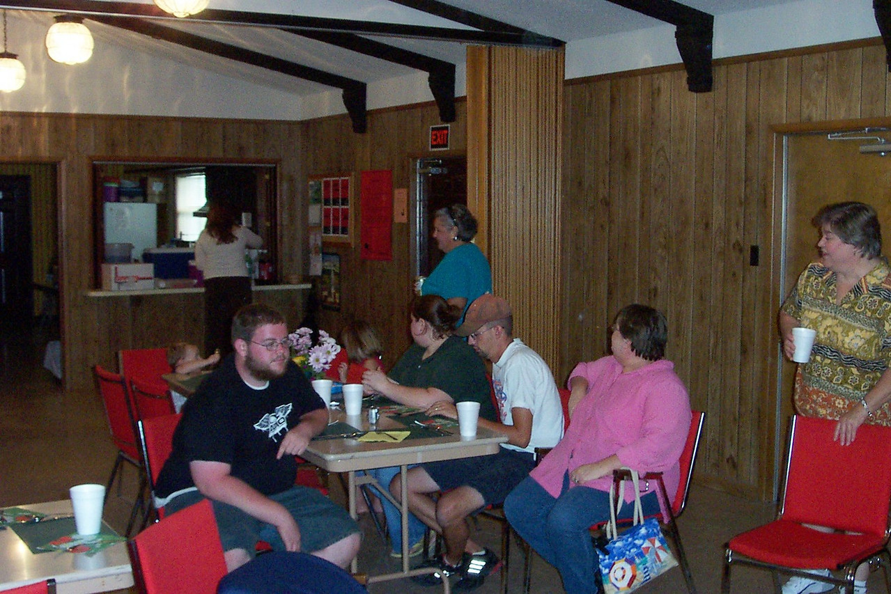 Seated at table: Wayne's wife Linda (in pink) and their kids Dustin (with beard) & Kim (in black).  Daniel (Kim's husband) is beside her.