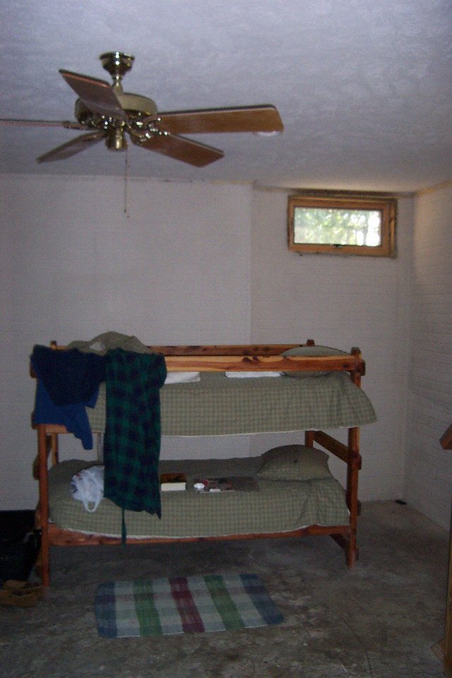 The basement and foundation was all new construction.  I was amazed at how tall it was!  Except for the tiny windows in this room (under the living room) I didn't feel like I was in a basement at all.  There were two identical sets of bunkbeds in this room, and I slept in the bottom of the other one (against the wall to the left).
