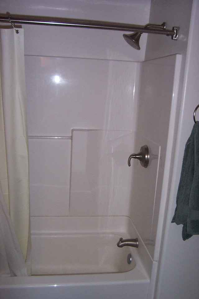 It had a built-in showertub.  Across from the bathroom, there was also a laundry room.