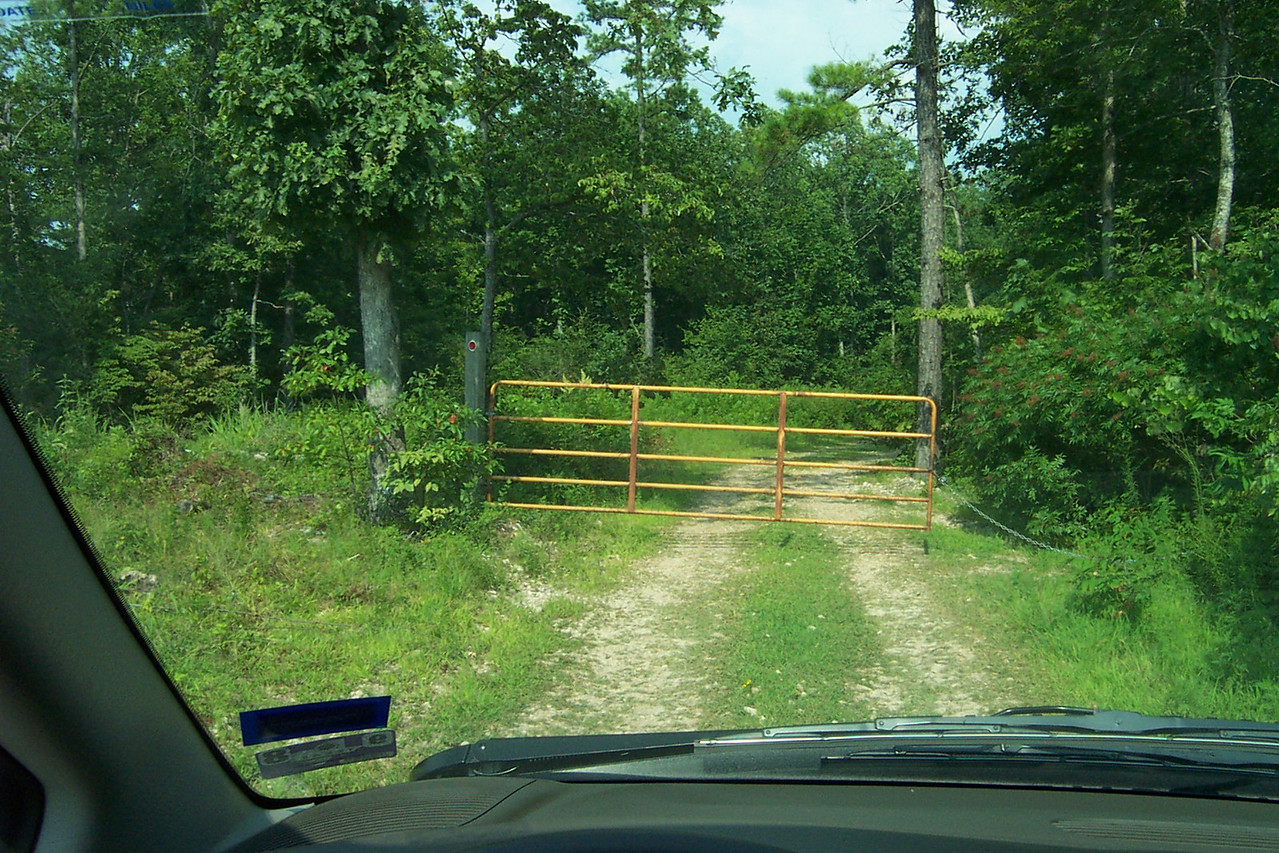 Finally, about five miles after we left the pavement, we get to the property's gate.
