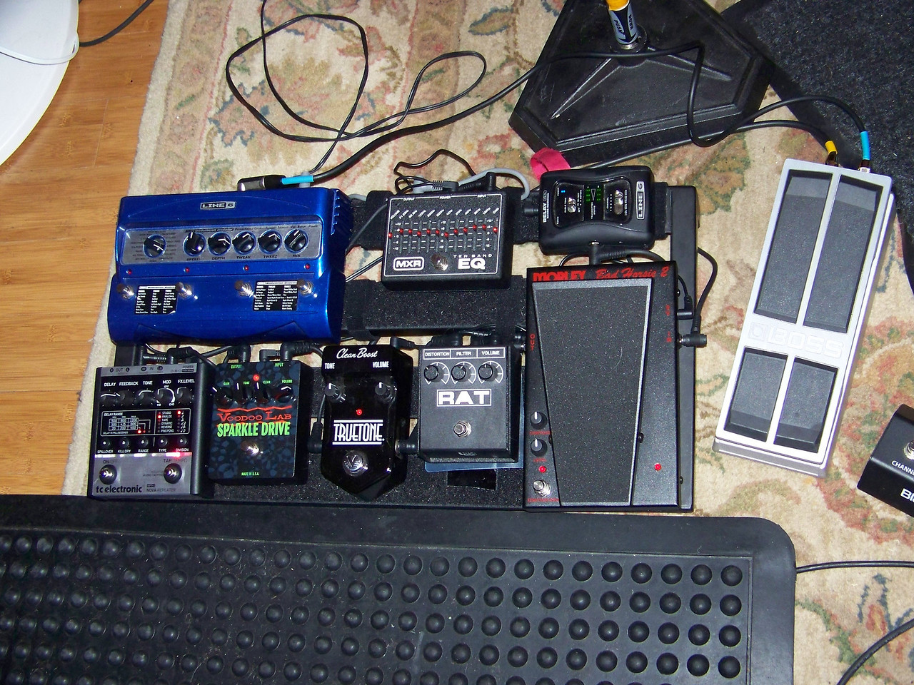 This is Mark's pedal board.  Using his feet, he can adjust volume, change sound qualities, and activate special effects while he plays.  Gee, you got enough technology there?  :-)