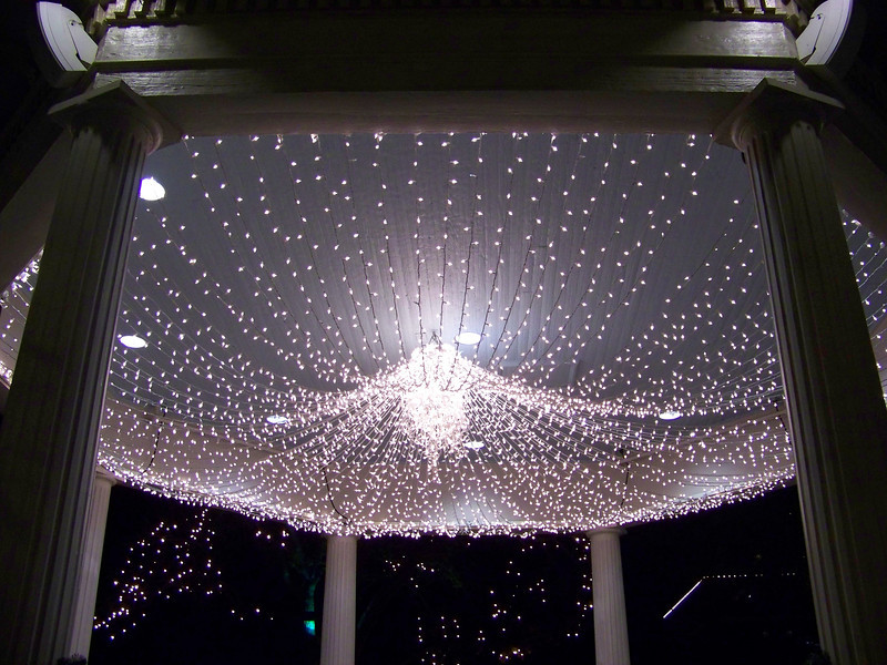 """A """"chandelier"""" made of Christmas lights is always strung inside the bandstand during the holidays."""