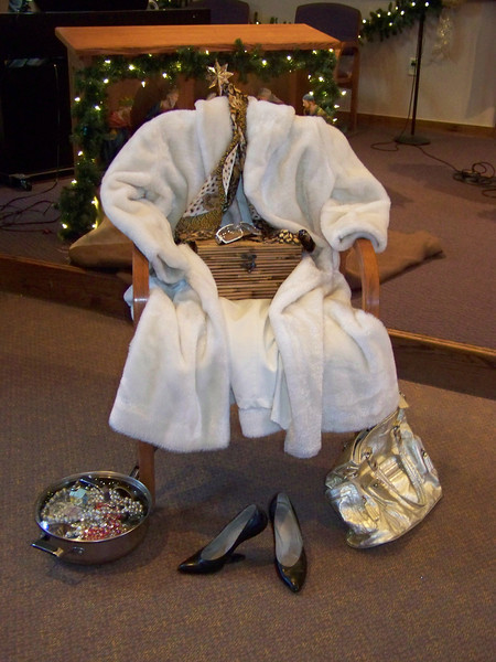 This display was in the front of the chapel.  The last few years, Aunt Pet was rarely seen without her white fur coat (faux fur, I think) and oversized shiny gold purse (at lower right).  Seeing the coat propped up in a chair like this really made it feel like she was with us.