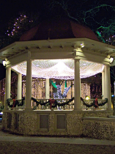 The bandstand on the Plaza, with the lights of the Comal County Courthouse in the background.  The ladies restroom mentioned on the historical marker is no longer open to the public (in this shot, you can see the windows for that room in the base).  I believe they now use it as a dressing room for the groups that perform here.