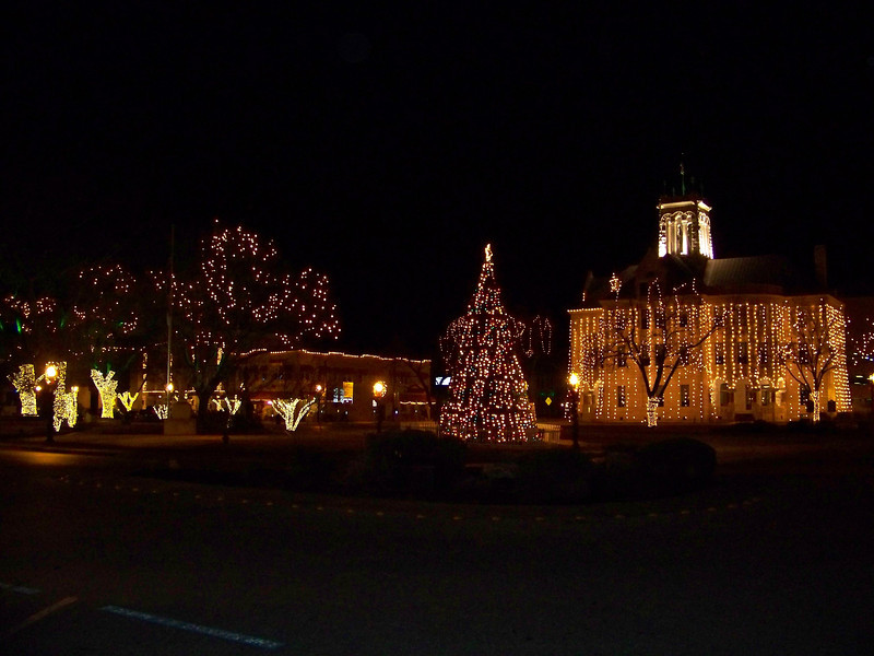 "Where two major streets intersect in downtown New Braunfels, there's a square with a large oval traffic island in the middle.  We call this area ""The Plaza,"" and it gets decorated every Christmas.  The bulding at right is the Comal County Courthouse."
