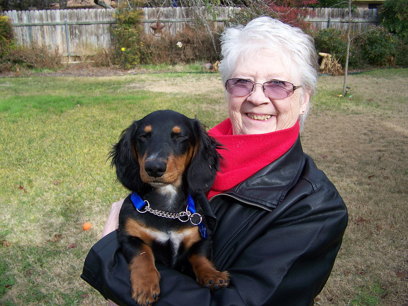 Sheri holding Taz in their backyard.  Such a sweet face!!!