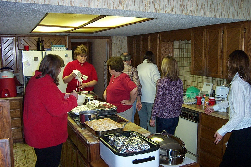 Assorted Pfeuffer relatives in the kitchen.  In the back, facing the camera, is my cousin Sharon (Billy's daughter).