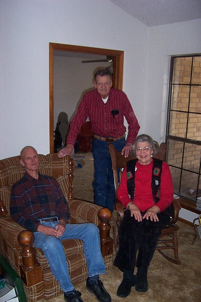 The next day, we had Christmas dinner with my Pfeuffer relatives at my Uncle Franklin's house.  Here's my Mom with her two brothers, Billy (standing) and Frank.