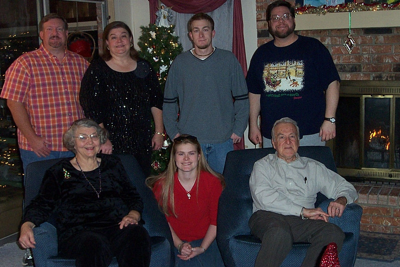 Our Christmas portrait.  Left to right:  Mark, Mom, Wendy, Jenna, Josh, Dad, and Jon.