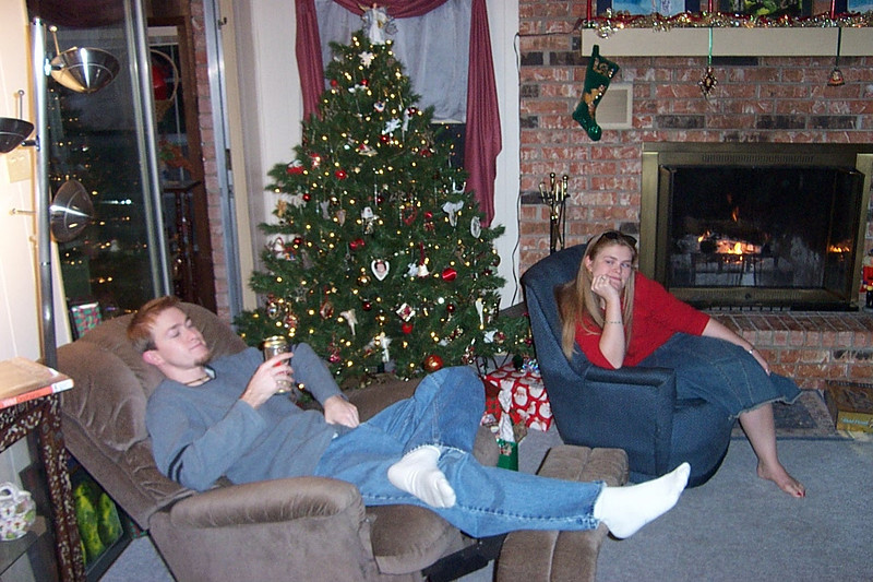 Josh and Jenna hang out by the tree, ready to open presents on Christmas Eve.