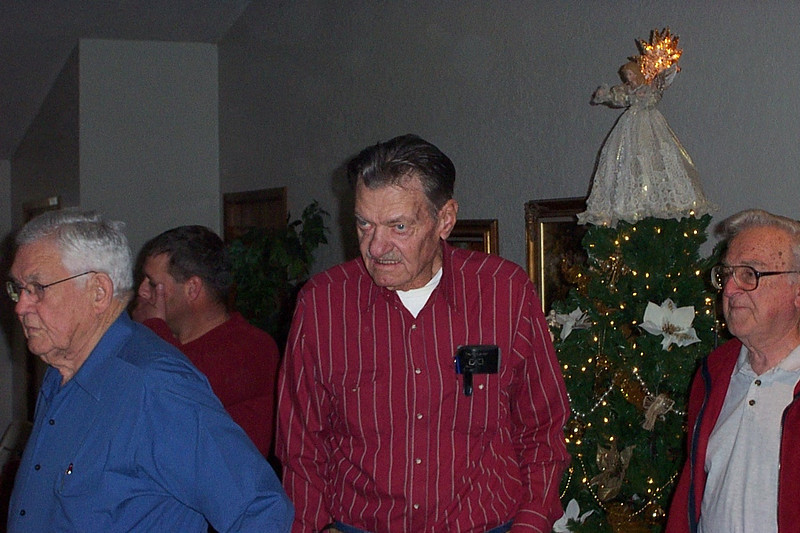Christmas with the Pfeuffers.  In the red striped shirt is my uncle Billy.  I believe the man in the blue shirt is Shirley's father.