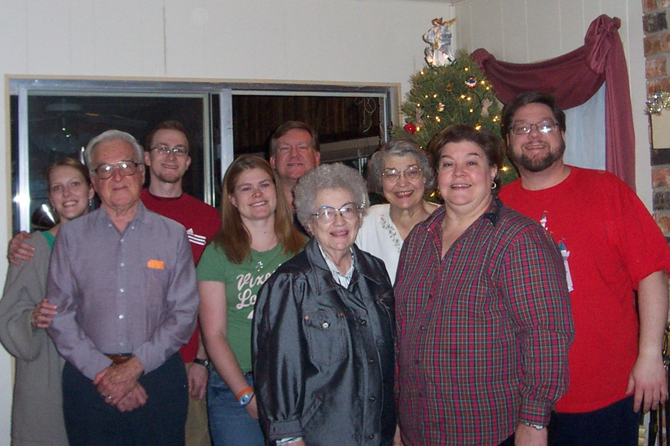 Our Christmas portrait.  Left to right:  Kalyn, Dad, Josh, Jenna, Mark, Aunt Pet, Mom, Wendy, and Jon.