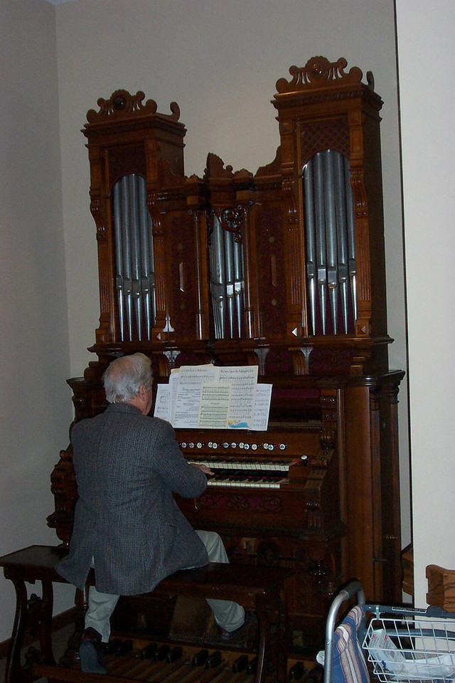 Dad plays the organ for a holiday service at Eden Home.