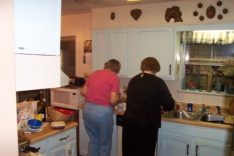 Mom and Wendy are busy in the kitchen.