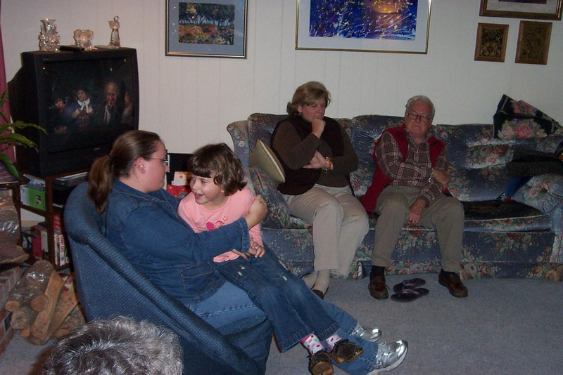 Left to right:  Amanda (Gayle's daughter) with Mary (Susan's daughter) on her lap; Susan and my dad (her Uncle Kenneth) are on the couch.