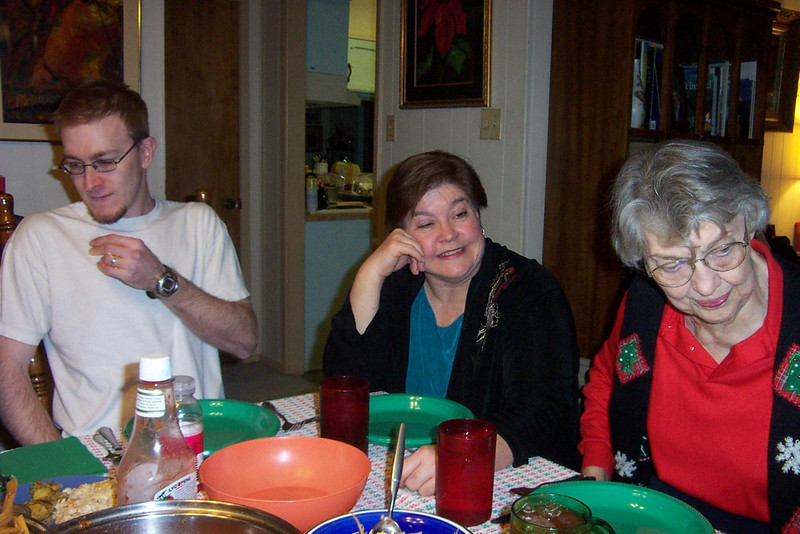 Josh, Wendy, and my mom Betty at the Christmas Eve table.