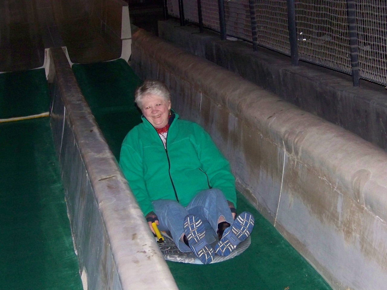 Here's Sheri at the end of her ride on the big slide.<br /> [Schlitterbahn's Hill Country Christmas 2009]