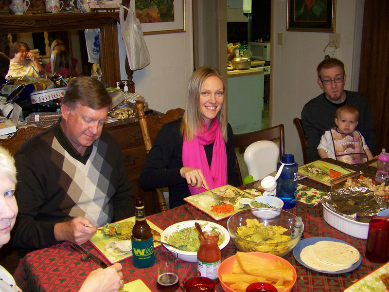 A sliver of Sheri, Mark, Kalyn, Josh and Embyr, with Wendy in the mirror.  Christmas eve dinner--with tamales!