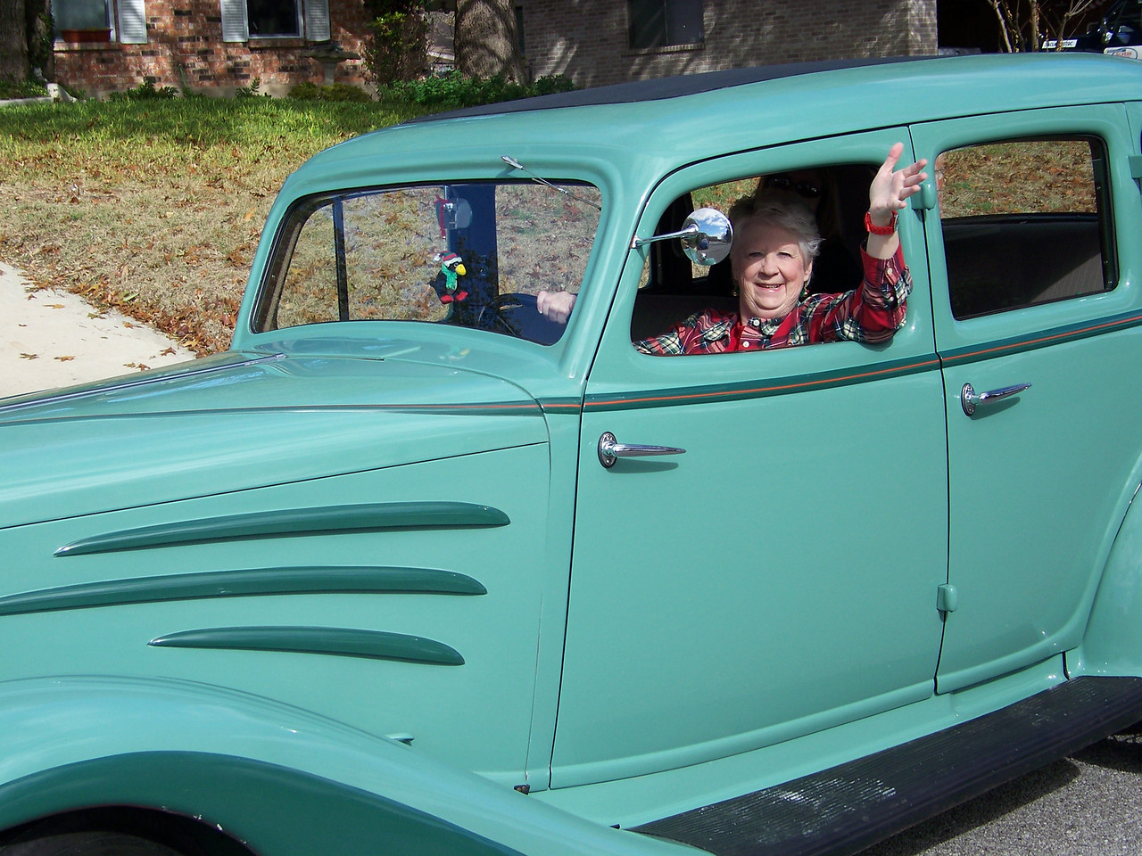 "Sheri says ""Let's go for a spin!""<br /> [1934 Auburn antique car]"