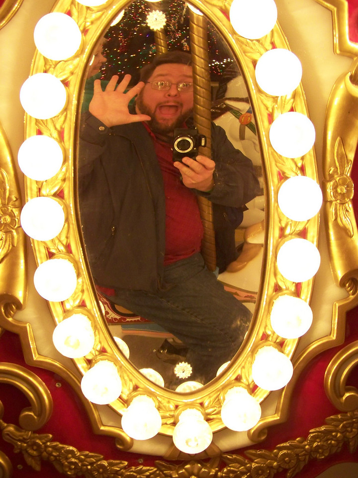Self portrait of idiot with camera on carousel.<br /> [Schlitterbahn's Hill Country Christmas 2009]