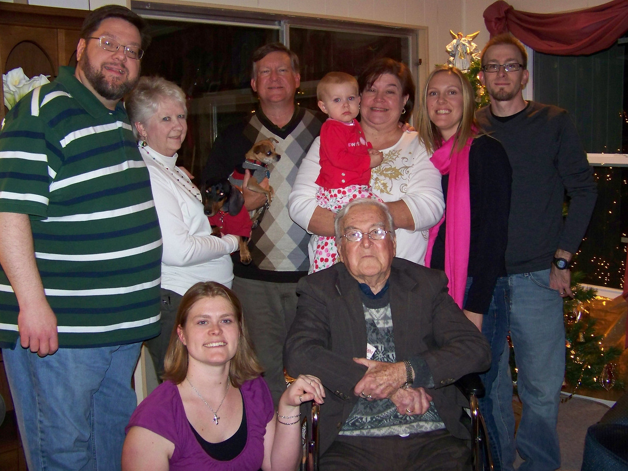 The whole family.  Standing:  Jon, Sheri holding Oscar, Mark holding Chica, Embyr being held by Wendy, Kalyn, Josh.  In front are Jenna and Dad.