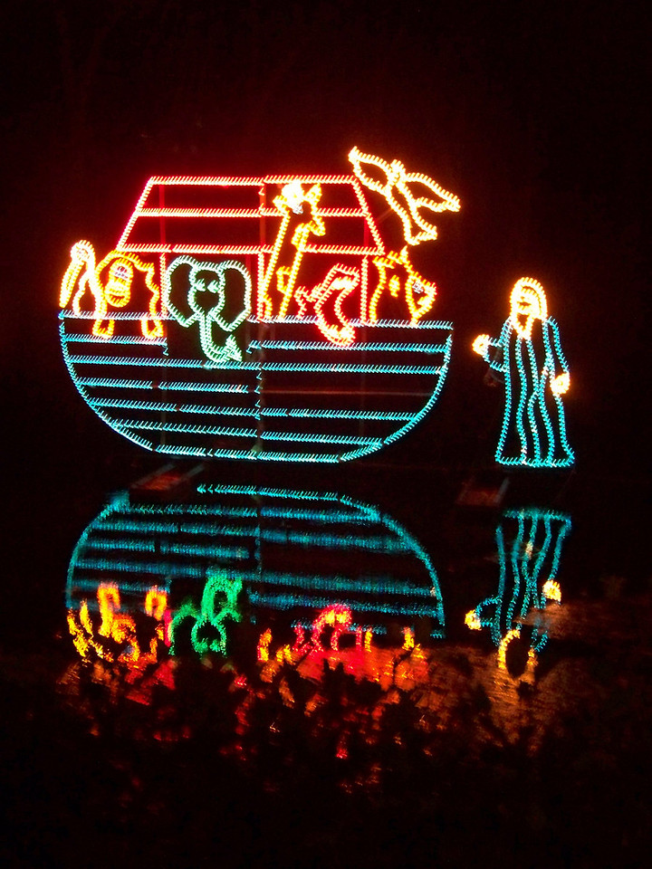 Noah's ark decoration, reflected in the Comal River.  Just how he got into Christmas I don't know.<br /> [Schlitterbahn's Hill Country Christmas 2009]