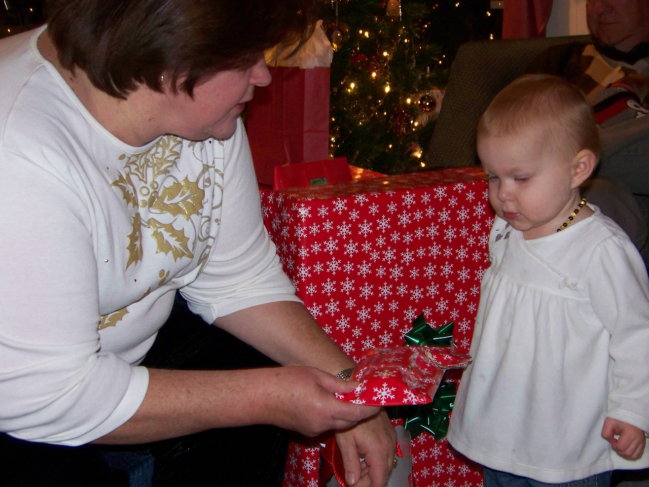 Time for presents!  Wendy gives Embyr her first one to open.