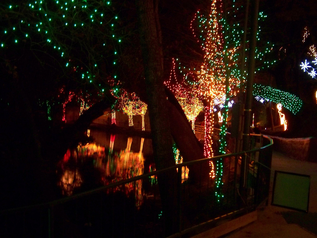 The walk along the Comal River was nicely decorated with a bazillion lights.<br /> [Schlitterbahn's Hill Country Christmas 2009]