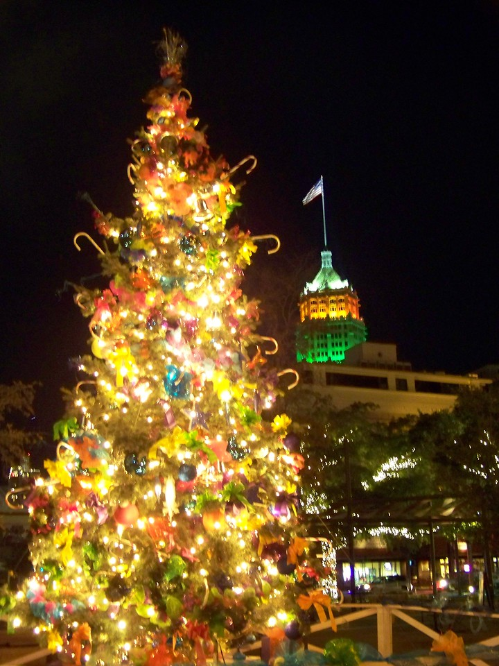 The Christamas tree in San Antonio's Main Plaza with the Tower Life Building in the background.