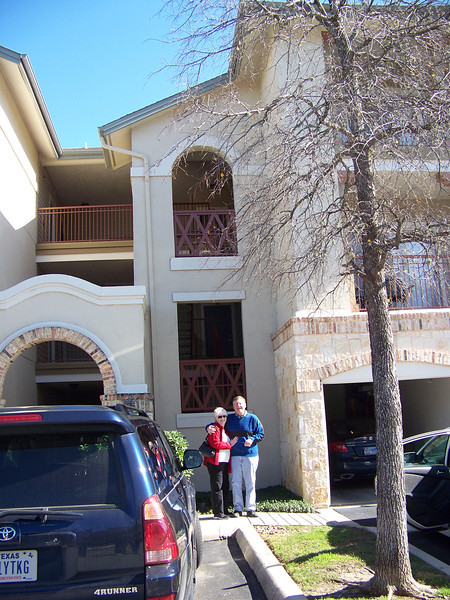 Mark and Sheri in front of Mark's apartment building in San Antonio.  That's his garage with the door open at right.  His apartment is directly above.