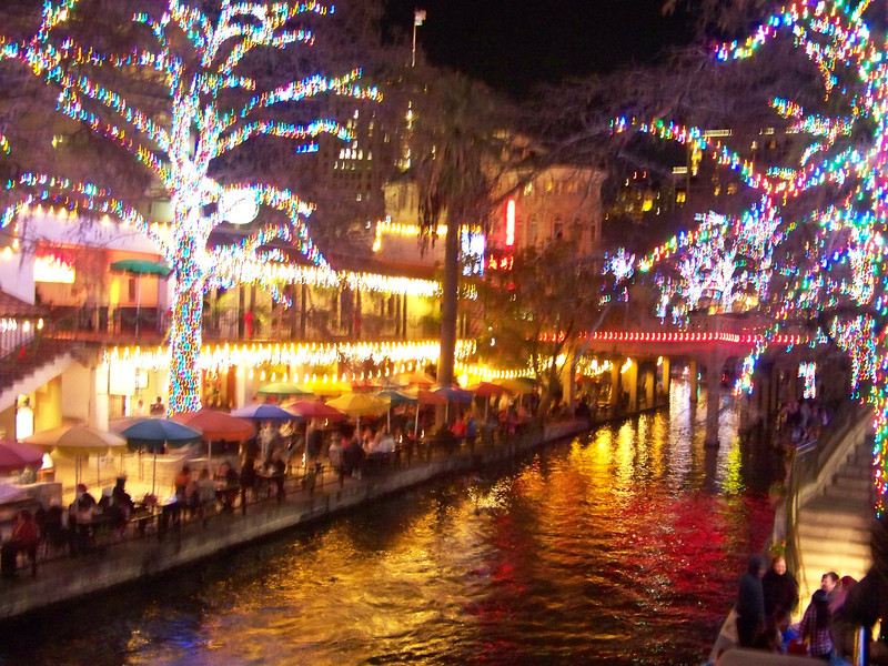 San Antonio River Walk Christmas lights.  The umbrellas on the other side are for the Casa Rio restaurant.