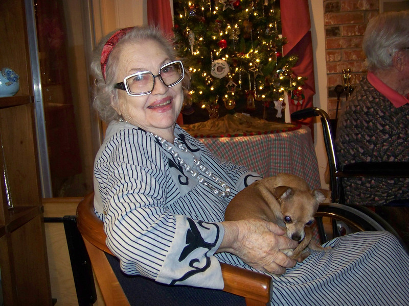 """Aunt Pet is a family friend (her real name is Aurora).  She and my Mom (Betty) met when they were assigned as college roommates, and that's where she picked up the nickname--they were known to their friends as """"Bet and Pet.""""  That's Mark's dog Chica on her lap."""