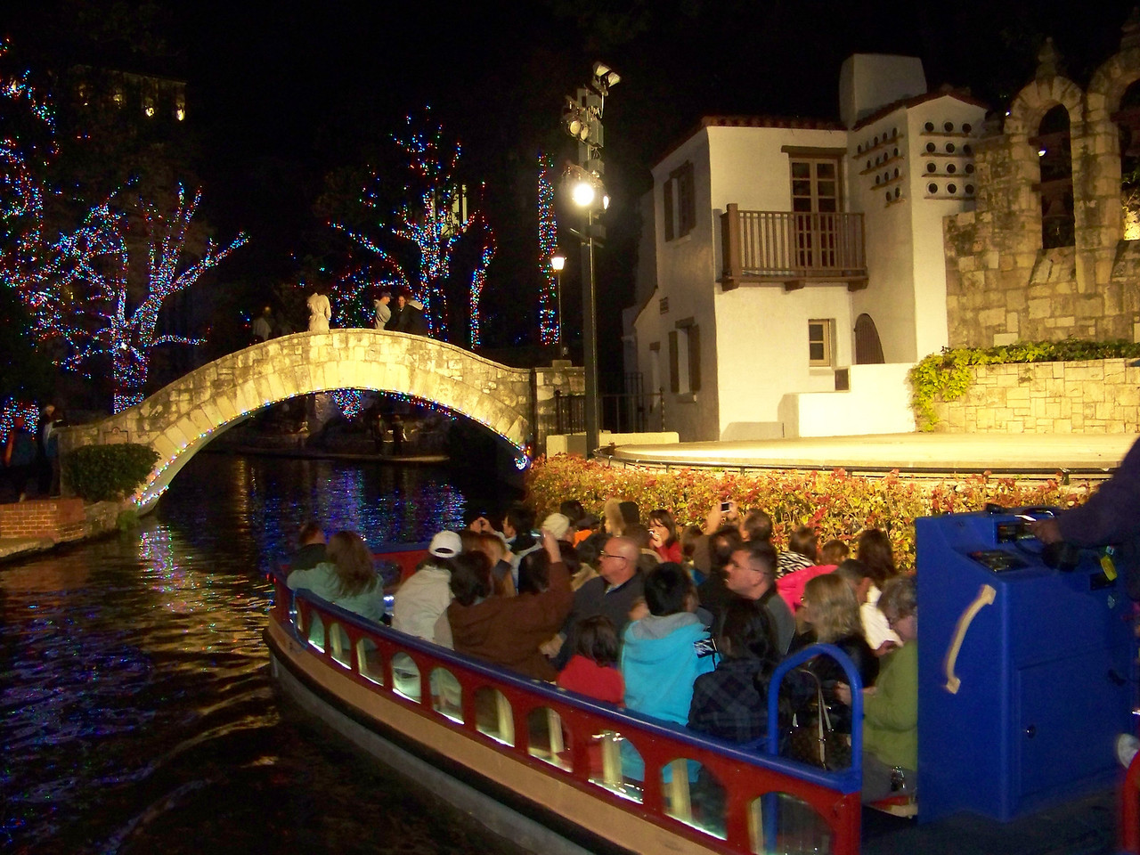San Antonio River Walk.  Here's one of the boats your can ride on the river.  Casa Rio also runs a boat with table seating so you can eat dinner as you cruise the river.
