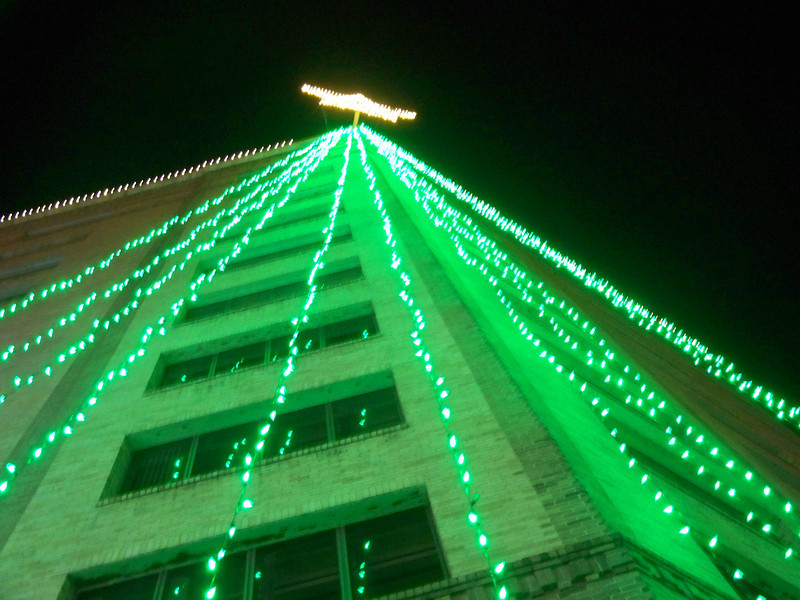 """San Antonio River Walk.  This shot is looking straight up a building next to the river that had a giant """"tree"""" made of Christmas lights and topped by a star.  I could never get a good angle on these lights from a distance."""