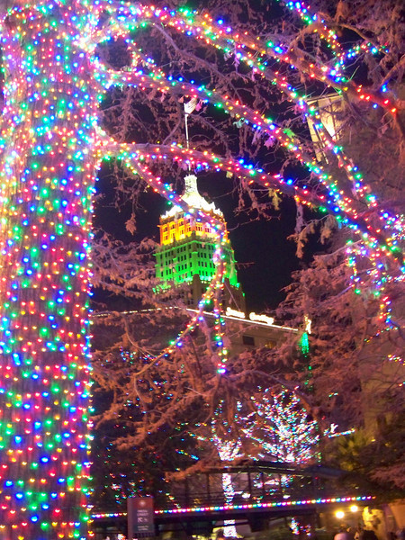 San Antonio's Tower Life Building and the Christmas lights on the River Walk.