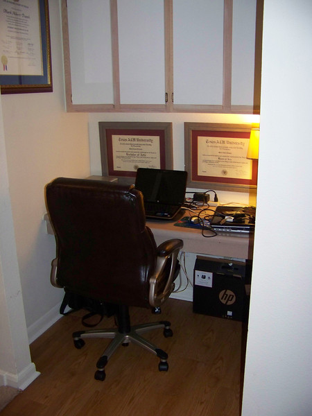 At the top of the stairs is a built-in office nook.