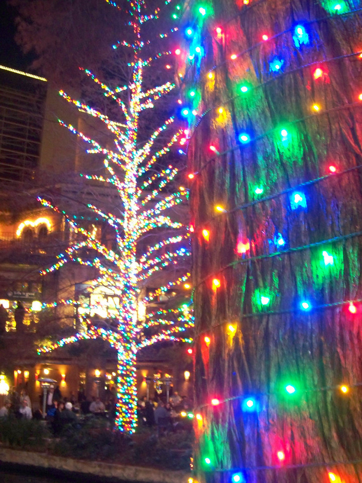 San Antonio River Walk at Christmas.  The close-up on the right side of this shot shows the lights' colors.  For some reason, the LED lights tend to wash out and look white in my photos, as seen on the tree on the left.