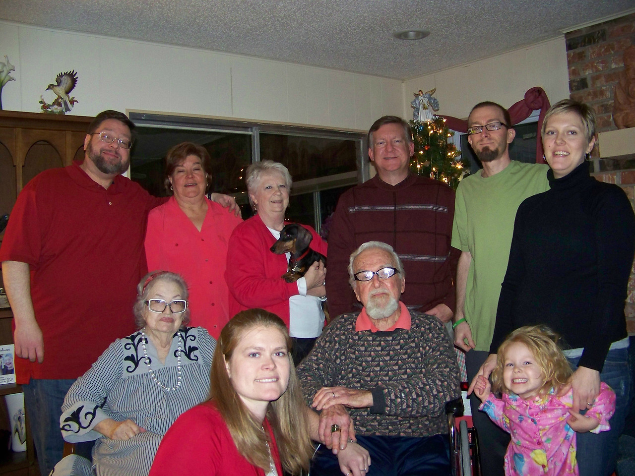 Our 2011 Christmas portrait, take one.  Standing, left to right:  Jon, Wendy, Sheri holding Oscar, Mark, Josh, Kalyn.  In front left to right:  Aunt Pet, Jenna, Dad, and Embyr.