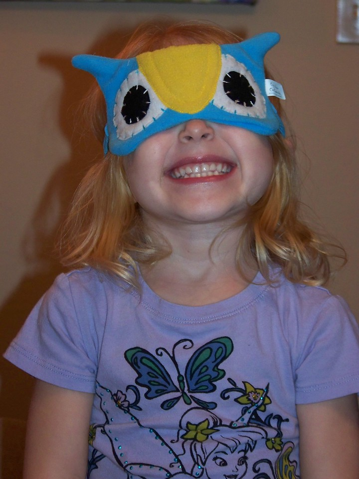 Embyr models the owl night-mask that was part of the birthday gift I gave Kalyn.  January 2013.