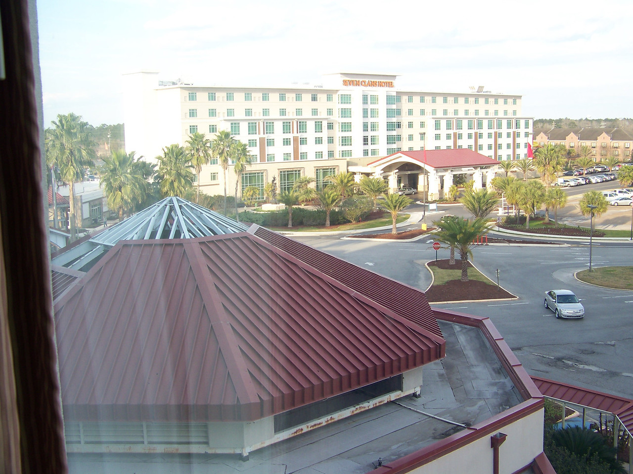 Looking out the window of our room at the Grand Hotel, we could see their other hotel, which is called the Seven Clans Hotel.  The casino at ground level connects the two hotels.<br /> [Coushatta Casino Resort]