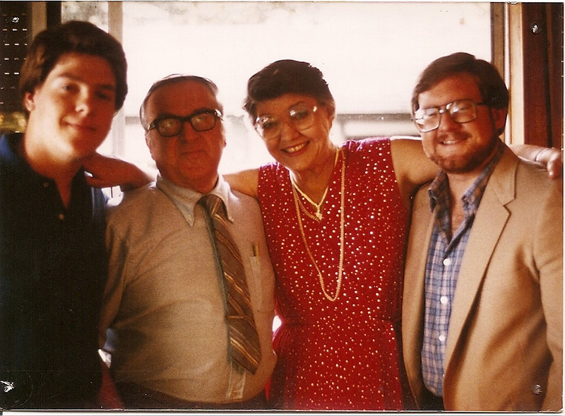 Jon, Dad, Mom, and Mark in the Mary Blvd. living room, about 1984.