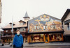 Jonathon in front of Oberammergau [murals painted on buildings] (November 22, 1990 / Oberammergau, Garmisch-Partenkirchen district, Bavaria, West Germany) -- Jonathon
