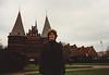 """MaryAnne in Lübeck with Holstein Gate """"Holstentor"""" (February 13, 1990 / Lübeck, Schleswig-Holstein, West Germany) -- MaryAnne"""
