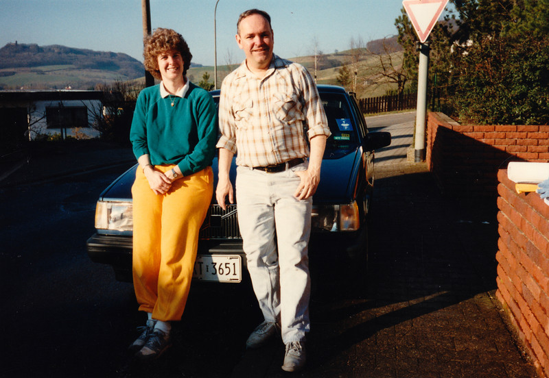 MaryAnne & David at home in front of our new Volvo (February 14, 1990 / Obere Hohl, Gimsbach, Rheinland-Pfalz, West Germany) -- MaryAnne & David